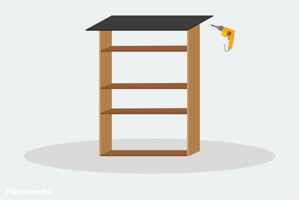 Dach auf dem Insektenhotel befestigen